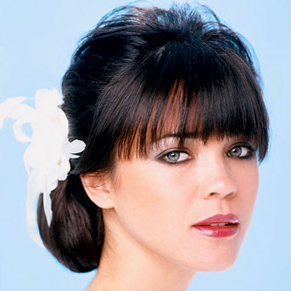 Side bun updo hairstyles for wedding with cute straight bangs