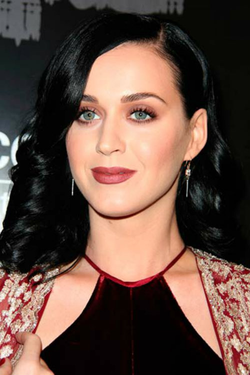 Katy Perry wearing medium dark raven curls hairstyles for pretty look