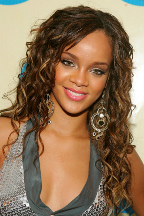 Rihanna with sexy long brown curly hair